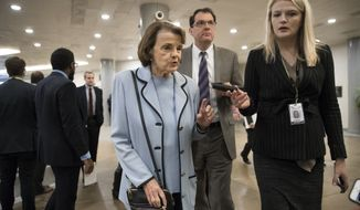 Sen. Dianne Feinstein, D-Calif., the ranking member on the Senate Judiciary Committee, takes a reporter's question as she walks to the Senate for a vote, at the Capitol in Washington, Thursday, Jan. 11, 2018. (AP Photo/J. Scott Applewhite) ** FILE **