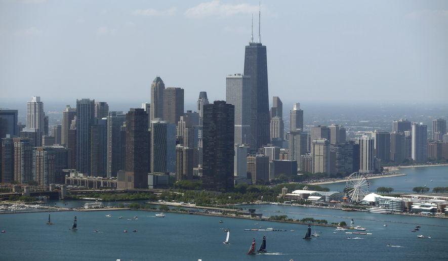 The Chicago skyline is shown in this July 2016 file photo. On March 15, 2018, the Windy City officially dropped its planned bid for hosting the 2026 FIFA World Cup. (AP Photo/Kiichiro Sato, File) **FILE**