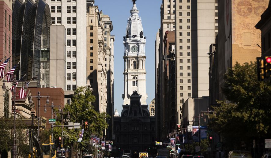 FILE - This Wednesday, Oct. 18, 2017, file photo shows City Hall in Philadelphia. The cities of Philadelphia and Pittsburgh are both attempting to woo Amazon to build its second headquarters in Pennsylvania. In Philadelphia, an independent development agency overseeing the city's bid said it spent $160,000 to develop and promote its proposal, including a website and video. (AP Photo/Matt Rourke, File)