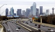 FILE - This Friday, Jan. 14, 2011, file photo shows highway IH-30 traffic with the Dallas skyline in the background. Dallas is one of the many cities vying to land Amazon's second headquarters. While Texas cities vying to land the new headquarters have been vocal about why they think they should win, they've resisted releasing copies of their proposals. (AP Photo/Tony Gutierrez, File)