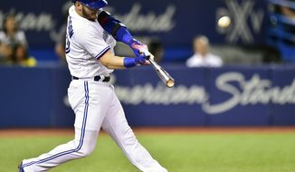 FILE - In this Aug. 15, 2017, file photo, Toronto Blue Jays' Josh Donaldson hits a three-run home run against the Tampa Bay Rays during the fifth inning of a baseball game in Toronto. The hot corner figures to be smoking Friday, Jan. 12, 2018, when players and team swap proposed salaries in arbitration. Donaldson, Baltimore's Manny Machado, Washington's Anthony Rendon and the Chicago Cubs' Kris Bryant were among the more than 170 players headed to the exchange. (Frank Gunn/The Canadian Press via AP, File)