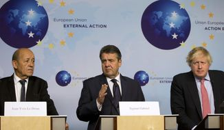 German Foreign Minister Sigmar Gabriel, center, speaks during a media conference after a meeting of the EU3 and Iran at EEAS headquarters in Brussels on Thursday Jan. 11, 2018. European Union foreign ministers held talks with their Iranian counterpart in Brussels on Thursday amid doubts over the future of an international agreement curbing the Islamic Republic's nuclear ambitions. (AP Photo/Virginia Mayo)