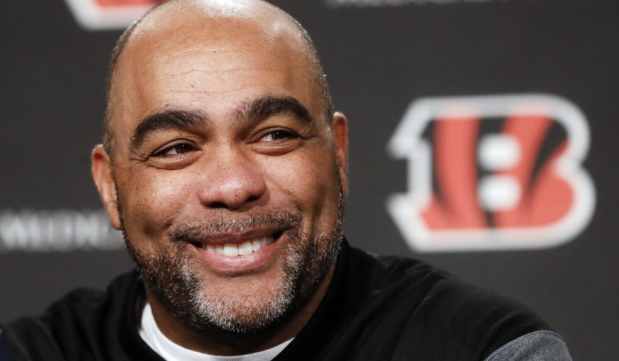 Cincinnati Bengals new NFL football defensive coordinator Teryl Austin smiles as he speaks during an introductory news conference at Paul Brown Stadium, Thursday, Jan. 11, 2018, in Cincinnati.  (AP Photo/John Minchillo)