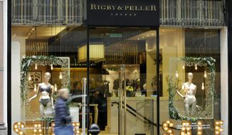 """A general view of lingerie boutique Rigby&Peller in Chelsea London, Thursday, Jan. 11, 2018. The luxury bra maker that supplied lingerie to Queen Elizabeth II has lost its royal warrant after a book described the atmosphere at Buckingham Palace. Rigby&Peller can no longer display the royal coat of arms after ex-owner, June Kenton, mentioned the royals in """"Storm in a D-cup.''. (AP Photo/Alastair Grant)"""