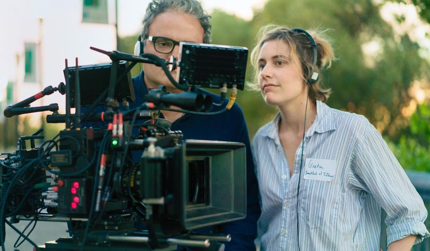 "This image released by A24 Films shows director Greta Gerwig on the set of ""Lady Bird."" Gerwig is nominated for outstanding directorial achievement by the Directors Guild of America for her direction on the film. (Merie Wallace/A24 via AP)"