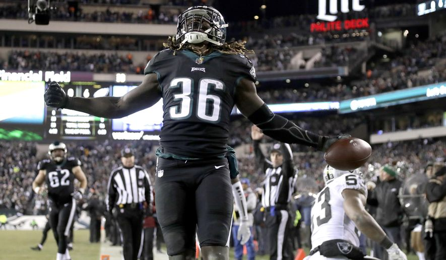 """FILE - In this Dec. 25, 2017, file photo, Philadelphia Eagles' Jay Ajayi reacts after scoring a touchdown during the first half of an NFL football game against the Oakland Raiders,in Philadelphia. The Eagles can jump aboard the Jay Train when they host Atlanta in an NFC divisional playoff Saturday and try to ride Ajayi to the conference title game. """"I feel really good, like, I feel really good,"""" said Ajayi, who has been bothered by knee issues. (AP Photo/Michael Perez, File)"""