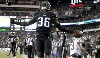 "FILE - In this Dec. 25, 2017, file photo, Philadelphia Eagles' Jay Ajayi reacts after scoring a touchdown during the first half of an NFL football game against the Oakland Raiders,in Philadelphia. The Eagles can jump aboard the Jay Train when they host Atlanta in an NFC divisional playoff Saturday and try to ride Ajayi to the conference title game. ""I feel really good, like, I feel really good,"" said Ajayi, who has been bothered by knee issues. (AP Photo/Michael Perez, File)"