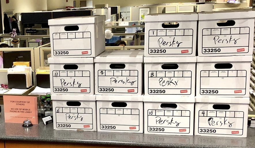 This photo released by John Shallman, shows boxes of petitions with signatures that call for the recall of Santa Clara County Judge Aaron Persky, a California judge who came under fire for his handling of a sexual assault case involving Stanford University swimmer Brock Turner,  at the Santa Clara County Registrar of Voters office in San Jose, Calif., Thursday, Jan. 11, 2018. Stanford University law professor Michele Dauber said the campaign to remove submitted nearly 100,000 signatures on Thursday to get the recall on the June 2018 ballot. (John Shallman via AP)