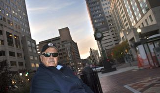 In this undated photo, Larry Markle sits on a bench and talks about his life in Harrisburg, Pa. Markle was released from prison, where he spent 42 years for the murder of Arthur Klinedinst when he was 17 in York. (Jason Plotkin/York Daily Record via AP)