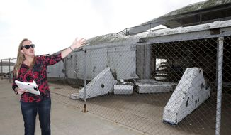 In a Friday, Dec. 23, 2017 photo, Sheryl Rozier, project manager for the Galveston Island Park Board of Trustees, talks about the damage to the Seawolf Park Pavilion caused by Hurricane Ike in 2008. A decision to repair the pavilion or demolish and rebuild it has been delayed by a review of city assets. (Jennifer Reynolds /The Galveston County Daily News via AP)