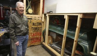 In this Jan. 4, 2018 photo,McLennan county maintenance and equipment director Wayne Canaday smiles as he discusses the future of the McLennan County tower clock and bell which lie in crates in Waco, Texas. (Jerry Larson/Waco Tribune Herald, via AP)