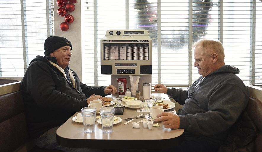 Nick Del Geurcio from Cedar Grove, N.J., and Tom Scorso from Belleville brave the storm to eat at North Arlington Diner on Thursday, Jan. 4, 2018 in North Arlington, N.J.  In Bergen County, people hunkered down at the Arlington Diner in North Arlington. A sign on the door asked patrons to knock the snow from their boots before coming in. The owner put it there after firefighters, fresh from digging out hydrants, tracked in snow and left the marble floor slick during the lunchtime rush, said Karen Smith, a server.  (Anne-Marie Caruso/The Record via AP)