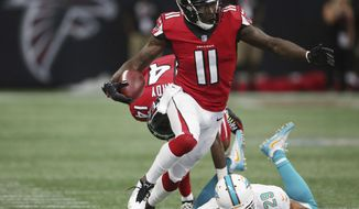 "FILE - In this Oct. 15, 2017, file photo, Atlanta Falcons wide receiver Julio Jones (11) runs against the Miami Dolphins during the second half of an NFL football game in Atlanta. Jones has a routine to deal with all the aches and pains. During the week, Jones is often limited in practice or doesn't even take the field. By the time game day rolls around, however, he's always ready to go.""He has a real process to do that,"" coach Dan Quinn said. ""We're fortunate that he's played with injuries and kind of knows the routine of how to do it."" That will be the case again for Saturday's NFC divisional playoff game against the top-seeded Philadelphia Eagles. (AP Photo/John Bazemore, File)"