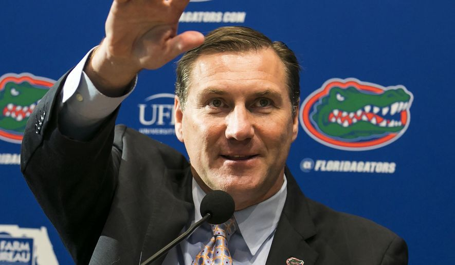 FILE - In this Nov. 27, 2017, file photo, Dan Mullen, the new head football coach at the University of Florida, is introduced during a news conference in Gainesville, Fla. Mullen filled out his staff Thursday, Jan. 11, 2018, by hiring Ron English as safeties coach. Mullen also announced assignments for his other nine assistants, including naming Billy Gonzales and John Hevesy co-offensive coordinators. Mullen is expected to call plays while Gonzales coaches receivers and Hevesy works with the offensive line.(Alan Youngblood/Star-Banner via AP, File)