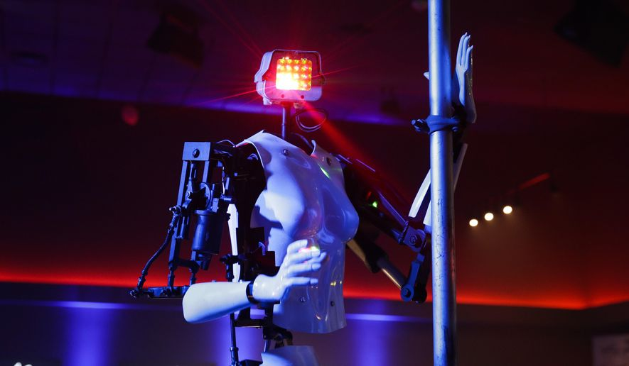 A pole-dancing robot built by British artist Giles Walker performs at a gentlemen's club Monday, Jan. 8, 2018, in Las Vegas. The event was held to coincide with CES International. (AP Photo/Jae C. Hong)