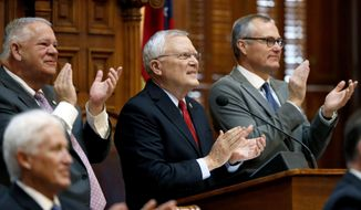 Georgia Gov. Nathan Deal, center, applauds as he acknowledges his wife, Sandra Deal, sitting up in the balcony while delivering the State of the State address at the state Capitol in Atlanta, Thursday, Jan. 11, 2018. (AP Photo/David Goldman)