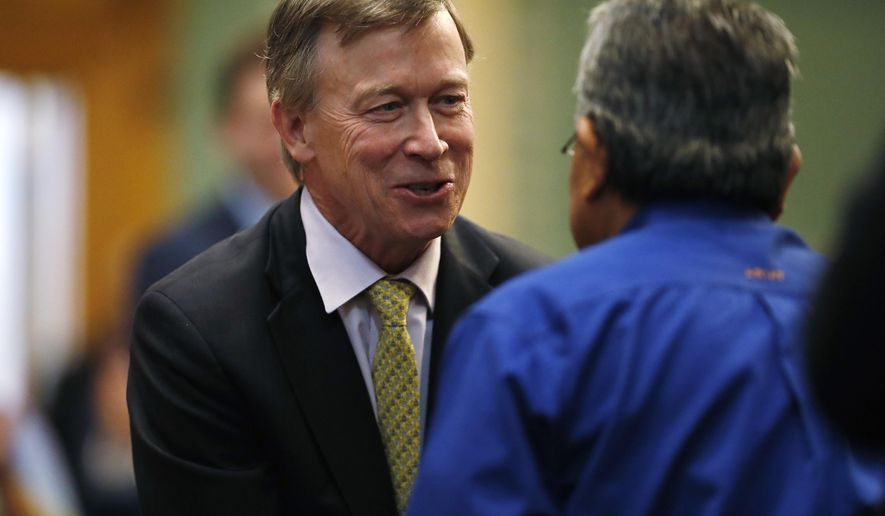 Term-limited Colorado Gov. John Hickenlooper, left, greets well-wishers on his way to delivering his final State of the State address to a joint assembly Thursday, Jan. 11, 2018, in the State Capitol in Denver. Hickenlooper encouraged lawmakers to take steps to improve the state's crumbling roadways and to commit to education efforts to prepare the populous for jobs in the ever-changing economy. (AP Photo/David Zalubowski)