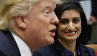 FILE - In this March 22, 2017 file photo, Administrator of the Centers for Medicare and Medicaid Services Seema Verma listen at right as President Donald Trump speaks during a meeting in the Roosevelt Room of the White House in Washington. The Trump administration says it's offering a path for states that want to seek work requirements for Medicaid recipients, and that's a major policy shift toward low-income people.  (AP Photo/Evan Vucci, File)