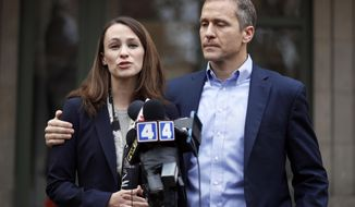 """FILE - In this Dec. 6, 2016, file photo, Missouri Gov.-elect Eric Greitens and his wife Sheena speak to the media in St. Louis after she had been robbed at gunpoint the day before. Responding to a news report that overshadowed his annual State of the State address Wednesday night, Jan. 10, 2018, the Republican governor acknowledged he's been """"unfaithful"""" in his marriage but denied allegations that he blackmailed the woman to stay quiet. The couple released a statement late Wednesday after the report that he had a sexual relationship with his former hairdresser in 2015. (AP Photo/Jeff Roberson, File)"""
