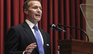 """FILE - In this Jan. 10, 2018, file photo, Missouri Gov. Eric Greitens delivers the annual State of the State address to a joint session of the House and Senate in Jefferson City, Mo. Responding to a news report that overshadowed his annual address, Greitens acknowledged he's been """"unfaithful"""" in his marriage but denied allegations that he blackmailed the woman to stay quiet. The Republican governor and his wife released a statement late Wednesday, after a report that he had a sexual relationship with his former hairdresser in 2015. (AP Photo/Jeff Roberson, File)"""