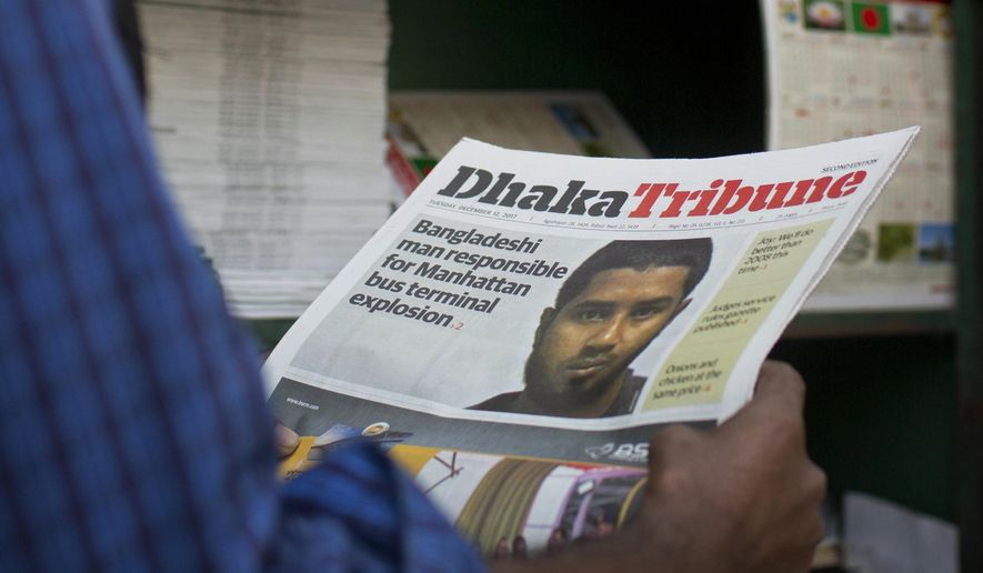 FILE - In this Dec. 12, 2017, file photo, a Bangladeshi man reads a national newspaper whose front pages shows the news of 27-year-old Bangladeshi man Akayed Ullah, in Dhaka, Bangladesh. Ullah was indicted Wednesday, Jan. 10, 2018, in the failed pipe bombing of the New York subway system in December. (AP Photo/A.M. Ahad, File)