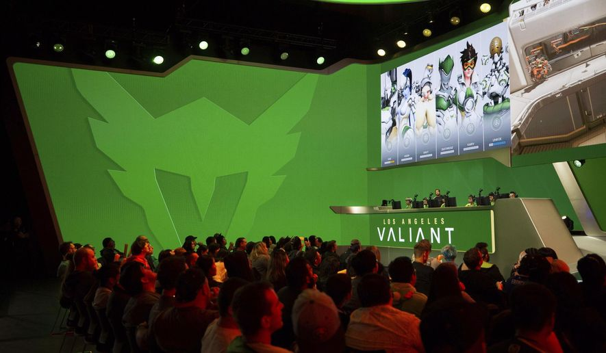 In this Dec. 6, 2017 photo provided by Blizzard Entertainment shows several members of the Los Angeles Valiant begin competition against the San Francisco Shock in a preseason match in the Overwatch League at Blizzard Arena in Burbank, Calif. The new Overwatch League is a well-funded attempt to combine cutting-edge esports competition with a traditional sports league structure. (Robert Paul/Blizzard Entertainment via AP) **FILE**