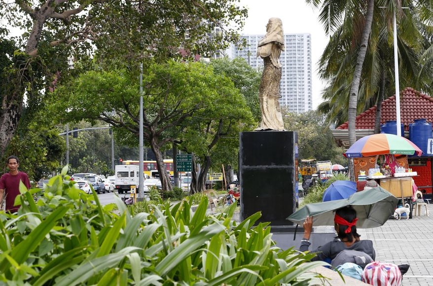 """A statue of a """"Comfort Woman"""" or alleged Filipino sex slave during WWII, stands along a scenic Baywalk in Manila, Philippines Thursday, Jan. 11, 2018. The statue, which symbolizes Filipino women forced to work in Japanese wartime brothels and inaugurated on Dec. 9, 2017, has created a controversy after Japanese Internal Affairs and Communications Minister Seiko Noda reportedly voiced """"displeasure"""" in her meeting with President Rodrigo Duterte. (AP Photo/Bullit Marquez)"""