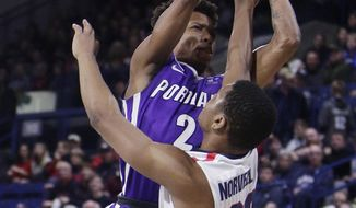 Portland guard JoJo Walker (2) and Gonzaga guard Zach Norvell Jr. (23) go after a rebound during the first half of an NCAA college basketball game in Spokane, Wash., Thursday, Jan. 11, 2018. (AP Photo/Young Kwak)