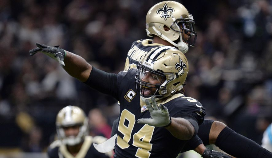 FILE - In this Jan. 7, 2018, file photo, New Orleans Saints defensive end Cameron Jordan (94) celebrates a defensive stop in the second half of an NFL football game against the Carolina Panthers, in New Orleans. Newly named All-Pro for the first time, Saints defensive Cam Jordan takes his playful yet menacing presence this weekend to the city where his father became a Pro Bowl tight end.  (AP Photo/Bill Feig, File)