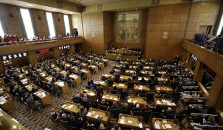 FILE - In this Jan. 9, 2017 file photo, Oregon Gov. Kate Brown delivers her inaugural speech to Oregon legislators in the Capitol House chambers in Salem, Ore. The intense national focus on sexual misconduct came to Oregon's capital this week, when lawmakers were given a training session on harassment and how to report it. (AP Photo/Don Ryan, File)