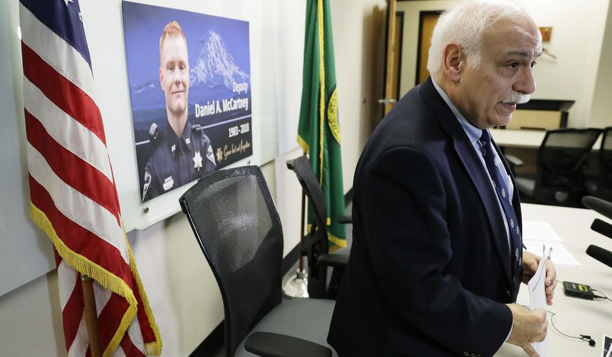 Pierce County Sheriff Paul Pastor stands up after speaking Wednesday, Jan. 10, 2018, during a news conference to update reporters on the status of the investigation into the fatal shooting of Deputy Daniel McCartney earlier in the week. (AP Photo/Ted S. Warren)