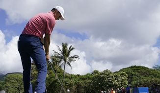 Jordan Spieth drives off the seventh tee during the first round of the Sony Open golf tournament, Thursday, Jan. 11, 2018, in Honolulu. (AP Photo/Marco Garcia)