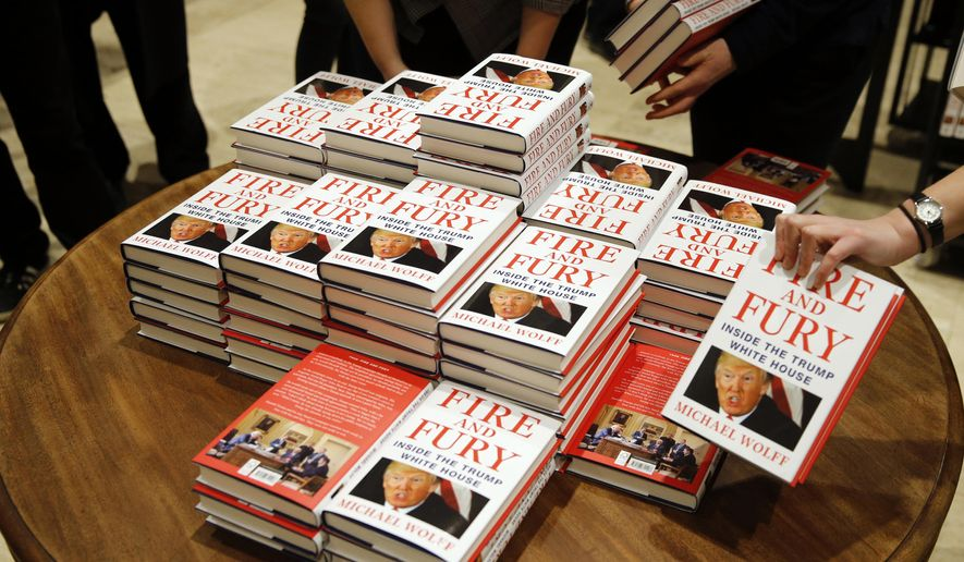 "FILE - In this Tuesday, Jan. 9, 2018, file photo, copies of Michael Wolff's ""Fire and Fury: Inside the Trump White House"" on display as they go on sale at a bookshop, in London. North Korea has found good material to attack President Donald Trump: Michael Wolff's bombshell new book, ""Fire and Fury."" (AP Photo/Alastair Grant, File)"