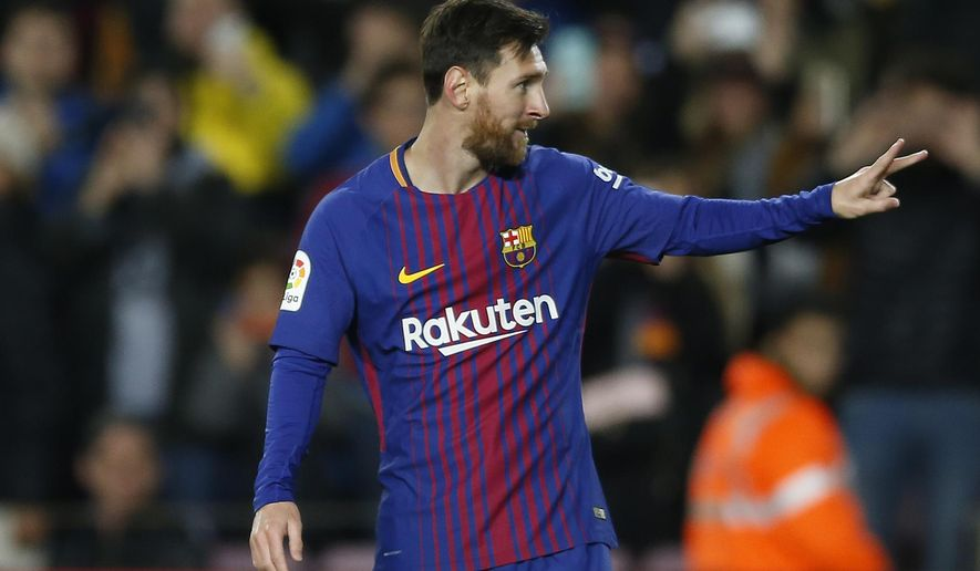 FC Barcelona's Lionel Messi celebrates after scoring during the Spanish Copa del Rey round of 16 second leg soccer match between FC Barcelona and Celta de Vigo at the Camp Nou stadium in Barcelona, Spain, Thursday, Jan. 11, 2018. (AP Photo/Manu Fernandez)