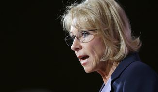 "FILE - In this Oct. 13, 2017, file photo, U.S. Education Secretary Betsy DeVos speaks during a dinner hosted by the Washington Policy Center in Bellevue, Wash. The U.S. Department of Education in an announcement Thursday, Jan. 11, 2018, says Texas for years violated federal law by denying students with disabilities access to proper public education. DeVos said in a statement, ""Far too many students in Texas had been precluded from receiving supports and services"" mandated by federal law. (AP Photo/Ted S. Warren, File)"