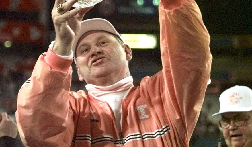 FILE - In this Jan. 4, 1999, file photo, Tennessee coach Phillip Fulmer holds the National Championship trophy after beating Florida State 23-16 in the Fiesta Bowl in Tempe, Ariz. As the new Tennessee athletic director, Fulmer says he wants to help bring back the stability that marked the Volunteers' athletic department during much of his tenure as the school's football coach. That stability has been missing for most of the last decade. (AP Photo/Jack Smith, File)