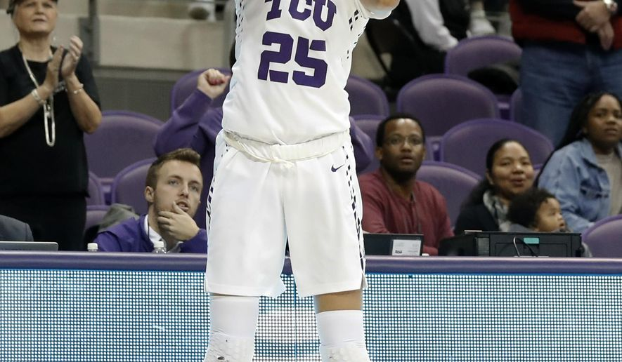 TCU guard Kianna Ray (25) shoots a 3-point basket late in the second half of an NCAA college basketball game against Texas on Wednesday, Jan. 10, 2018, in Fort Worth, Texas. TCU won 79-77. (AP Photo/Tony Gutierrez)