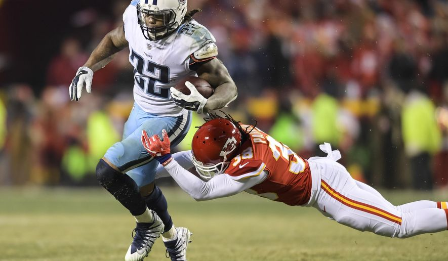 FILE - In this Jan. 6, 2018, file photo, Tennessee Titans running back Derrick Henry (22) evades a tackle by Kansas City Chiefs free safety Ron Parker (38) during an NFL wild-card playoff game in Kansas City. Henry is much happier with his performance in his NFL playoff debut after setting a Tennessee franchise record with 191 yards from scrimmage. Now the 2015 Heisman Trophy winner gets the chance to see if he can run like that against the New England Patriots. (AP Photo/Reed Hoffmann, File)