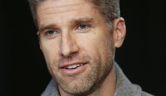 Kyle Martino, a former United States national team midfielder and NBC Sports' Premier League broadcaster, discusses his campaign to replace longtime incumbent Sunil Gulati as president of the United States Soccer Federation, during an interview Thursday Jan. 11, 2018, in New York. (AP Photo/Bebeto Matthews)