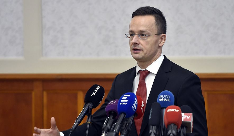 Hungarian Minister of Foreign Affairs and Trade, Peter Szijjarto, holds a press conference in response to the recent remarks by Romanian Prime Minister Mihai Tudose in the Ministry of Foreign Affairs and Trade in Budapest, Hungary, Friday, Jan. 12, 2018. (Zoltan Mathe/MTI via AP) ** FILE **