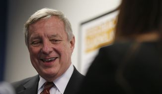 "Sen. Dick Durbin, an Illinois Democrat, speaks to students of Year Up Chicago, a one-year long job training program that provides low-income young adults, Friday, Jan. 12, 2018, in Chicago. The senator present at a White House immigration meeting says President Donald Trump used vulgar language to describe African countries, saying he ""said these hate filled things and he said them repeatedly."" (AP Photo/Kiichiro Sato)"