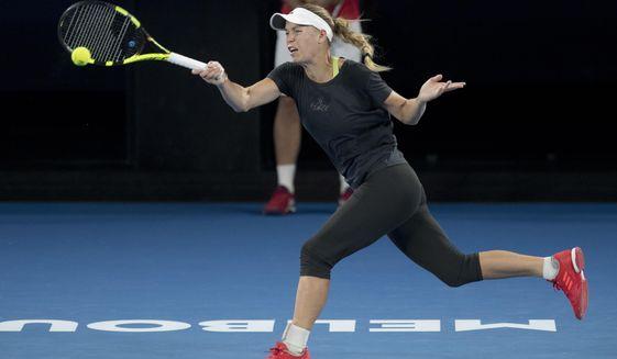 Denmark's Caroline Wozniacki makes a forehand return during a practice session on Rod Laver Arena ahead of the Australian Open tennis championships in Melbourne, Australia Friday, Jan. 12, 2018. (AP Photo/Mark Baker)