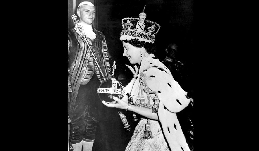 FILE - In this June 2, 1953 file photo, Britain's Queen Elizabeth II wearing the bejeweled Imperial Crown and carrying the Orb and Scepter with Cross, leaves Westminster Abbey, London, at the end of her coronation ceremony. Queen Elizabeth II reveals the secrets of giving a speech while wearing a weighty crown, in unusually candid comments that are part of a new documentary to be aired on the BBC on Sunday Jan. 14, 2018, on her coronation and the symbolism of the crown jewels. (AP Photo/File)