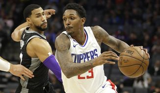 LA Clippers guard Lou Williams, right, drives against Sacramento Kings guard Garrett Temple during the first quarter of an NBA basketball game Thursday, Jan. 11, 2018, in Sacramento, Calif. (AP Photo/Rich Pedroncelli)