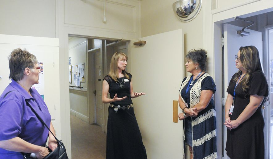 In this Aug. 24, 2017, photo, Alyssa Cromwell with Advocates Against Family Violence gives a tour of the Hope's Door shelter, which houses victims of domestic violence in Caldwell, Idaho. (Chris Bronson/The Idaho Press-Tribune via AP)