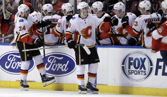 Calgary Flames' Matthew Tkachuk (19) is congratulated after scoring a goal during the second period of the team's NHL hockey game against the Florida Panthers, Friday, Jan. 12, 2018, in Sunrise, Fla. (AP Photo/Lynne Sladky)