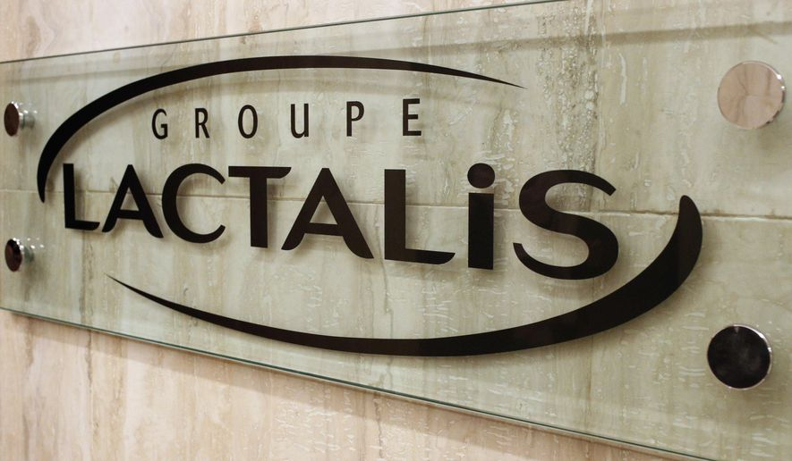 The logo of Groupe Lactalis is seen as Head of Communication & External Relations, Michel Nalet attends a press conference in Paris, Thursday, Jan. 11, 2018. French President Emmanuel Macron has criticized French diary giant Lactalis after major supermarkets admitted this week that baby food recalled over fears of salmonella contamination still made it onto French shelves. (AP Photo/Francois Mori)