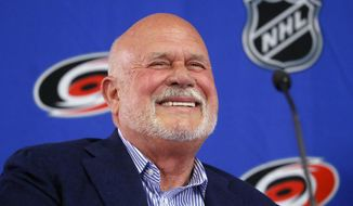Former Carolina Hurricanes NHL hockey team majority owner Peter Karmanos laughs during a press conference where Thomas Dundon was introduced as the new majority owner at PNC Arena in Raleigh, N.C., Friday, Jan. 12, 2018. (Chris Seward/The News & Observer via AP)