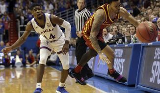 Kansas guard Malik Newman (14) watches as Iowa State guard Nick Weiler-Babb (1) tries to save the ball from going out of bounds during the second half of an NCAA college basketball game in Lawrence, Kan., Tuesday, Jan. 9, 2018. Kansas defeated Iowa State 83-78. (AP Photo/Orlin Wagner)