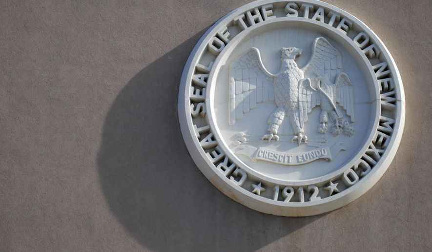The New Mexico state seal casts a shadow on the state Capitol on Friday, Jan. 12, 2018, in Santa Fe, N.M. Criminal justice initiatives and state spending increases for public education, law enforcement, Medicaid and economic development are at the top of the agenda at the new Mexico Legislature prepares for a 30-day session beginning Tuesday, Jan. 16. (AP Photo/Morgan Lee)